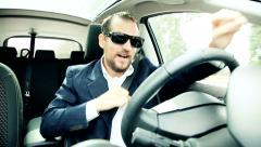 Succesful business man driving car making crazy moves celebrating deal Stock Footage