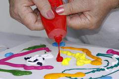 Stock Photo of painting with acrylic paints, hands