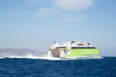 Green ferry speed boat on the greek islands. Stock Photos