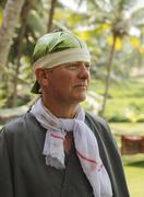 man with a banana leaf on his head, ayurvedic treatment, bethsaida hermitage  - stock photo