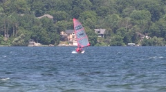 Hot windy summer day by the lake with boats and wind surfers in Barrie Ontario Stock Footage