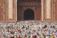 Worshiping at the Taj Mahal - stock photo