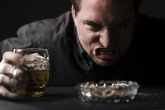 aggressive man with beer - stock photo
