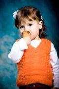 small girl eating an ice cream cone - stock photo