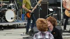 Kids  Dance as Rock Band Performs In Concert Stock Footage
