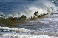 Waves with sand near kovalam, malabar coast, malabar, kerala, southern india, Stock Photos