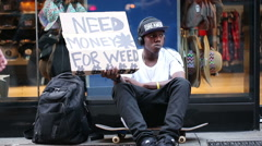 Homeless Sign Need Money for Weed Black Teen New York City NYC USA Slow Motion Stock Footage