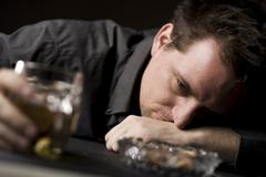 drunk man with beer - stock photo