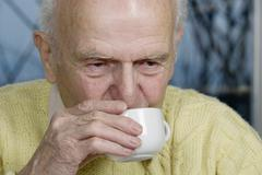 Old man having a cup of coffee, germany, europe Stock Photos