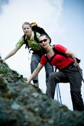 Two young women hiking on steep terrain Kuvituskuvat