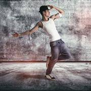 Hip young man doing a dance routine Stock Photos