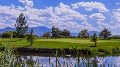Stock Video Footage of Time lapse of golf course players with clouds