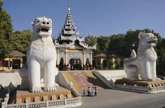 Entrance with typical mythical lions, chinthe, on mandalay hill, mandalay, my Stock Photos