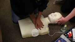 Top view practicing CPR Stock Footage