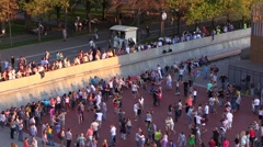 Crowd of people dance on a summer evening river city waterfront. Slow Motion. Stock Footage
