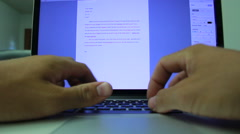 POV Man Typing on computer in office working Stock Footage