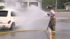 Firefighters charity fundraiser car wash using fire trucks - stock footage