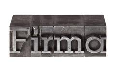 "old lead letters forming the word ""firma"", german for ""company"" - stock photo"