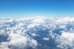 Above view of white clouds in blue sky Stock Photos