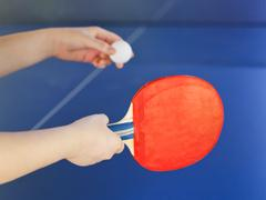 girl plays in table tennis with red racket - stock photo