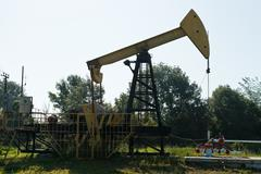 pumpjack pumps oil outdoors - stock photo