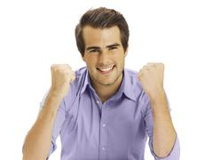 Stock Photo of businessman clenching fists, happy, optimistic