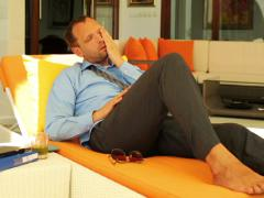 Bored, lazy businessman relaxing on sunbed NTSC Stock Footage