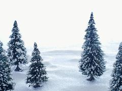 Artificial winter landscape with fir trees Stock Photos