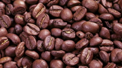 close up footage of rotating roasted coffee beans, hight detailed - stock footage