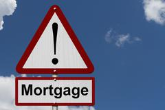 mortgage caution sign - stock photo