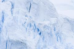 Ice crevasses created by glacier calving radiating blue Lemaire Channel - stock photo