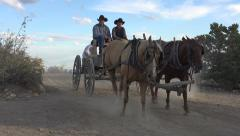 Antique historic horse wagon cowboys religion pioneer Stock Footage