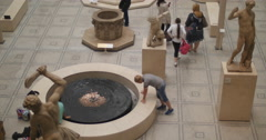 Young boy looks into V&A fountain 4K Stock Footage