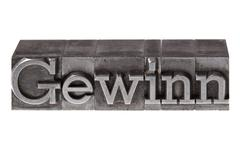 "old lead letters forming the word ""gewinn"", german for profit - stock photo"