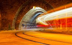 tram drives in the tunnel at night, long endurance - stock photo