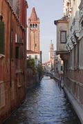 kanal in venedig mit booten - stock photo