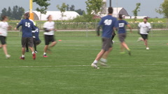 Cold wet rain high wind at college university ultimate frisbee sports event Stock Footage