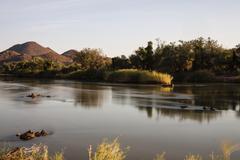 Stock Photo of View over the border river of Kunene towards Angola Kaokoland Kunene Region