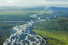 Aerial view glacial river meandering over the sandy surface of the Kuvituskuvat