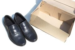 Shoes and box Stock Photos