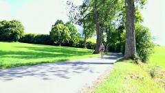 Young woman riding a unicycle Stock Footage