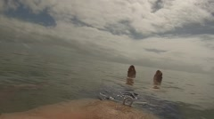 Mans feet floating in the Ocean Stock Footage