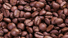 4k raw close up footage of rotating roasted coffee beans - stock footage