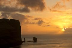 Kellingin and Risin sea stacks petrified trolls according to legend at sunset - stock photo