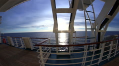 Super cool dolly shot of sun off the deck of a cruise ship Stock Footage