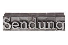 "old lead letters forming the word ""sendung"", german for consignment or progra - stock photo"