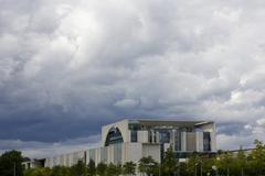 Stock Photo of Dramatic sky over the Bundeskanzleramt or Chancellors Office building