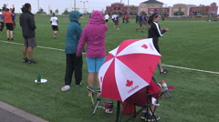 Stock Video Footage of Cold wet rain high wind at college university ultimate frisbee sports event