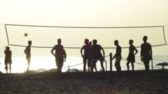 Silhouettes Of Volleyball Players On The Beach At Sunset - 6 - stock footage