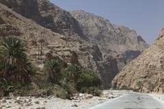 Road in the Wadi Shab mountain ravine Hadjar Gebirge Hadschar Gebirge Tiwi - stock photo